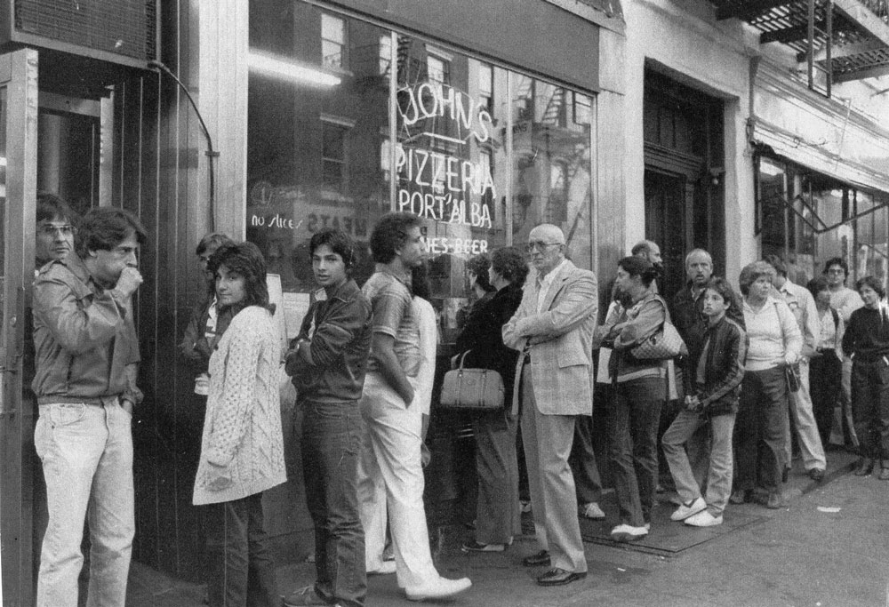Customers wait in line in the '80s—and still do today.